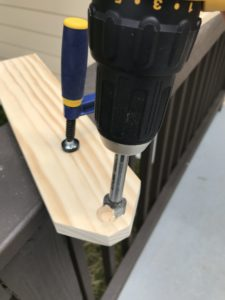 drilling holes into side piece of wood