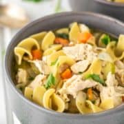 homemade chicken noodle soup in grey bowl
