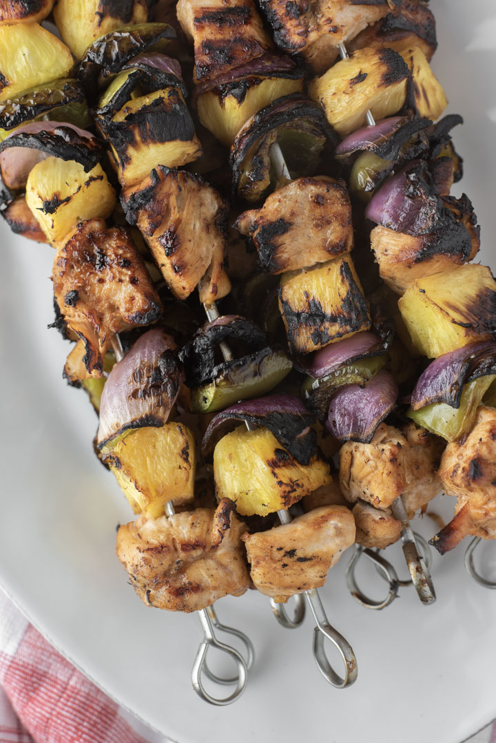 overhead shot of Hawaiian chicken kebabs on plate