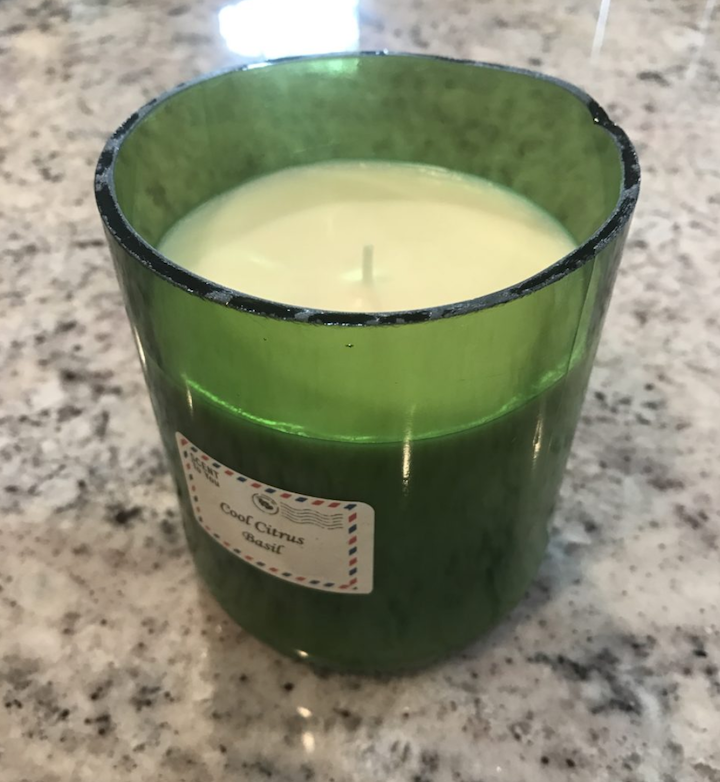 homemade soy candle in cut wine bottle