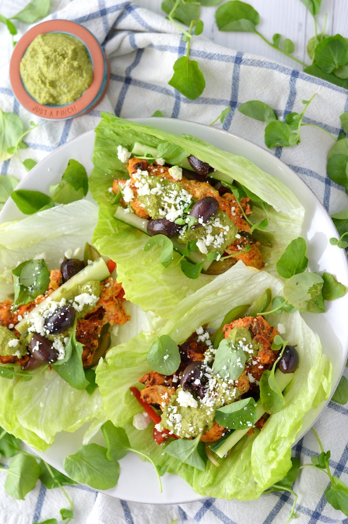overhead shot of lettuce wraps with greek chicken on white plate