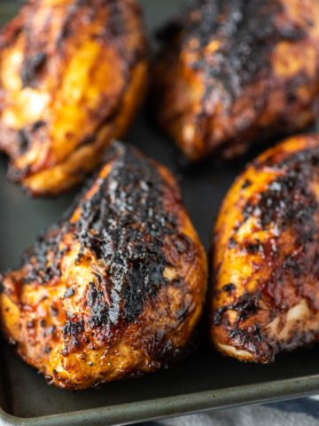 grilled BBQ chicken on baking sheet