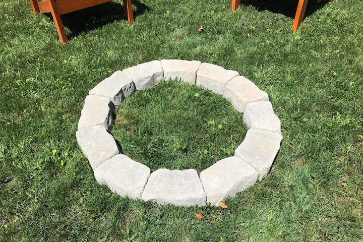forming circle for DIY fire pit with flagstone wall blocks