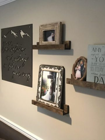 shelves on wall with pictures and art