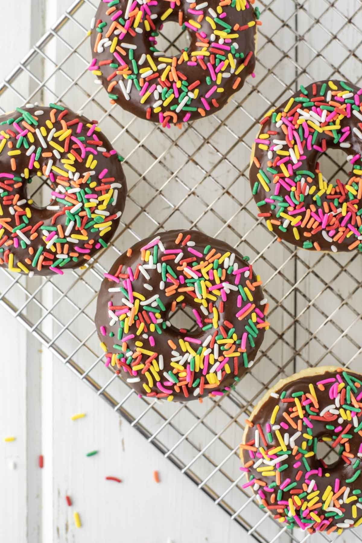 overhead shot of baked donuts on cooking rack