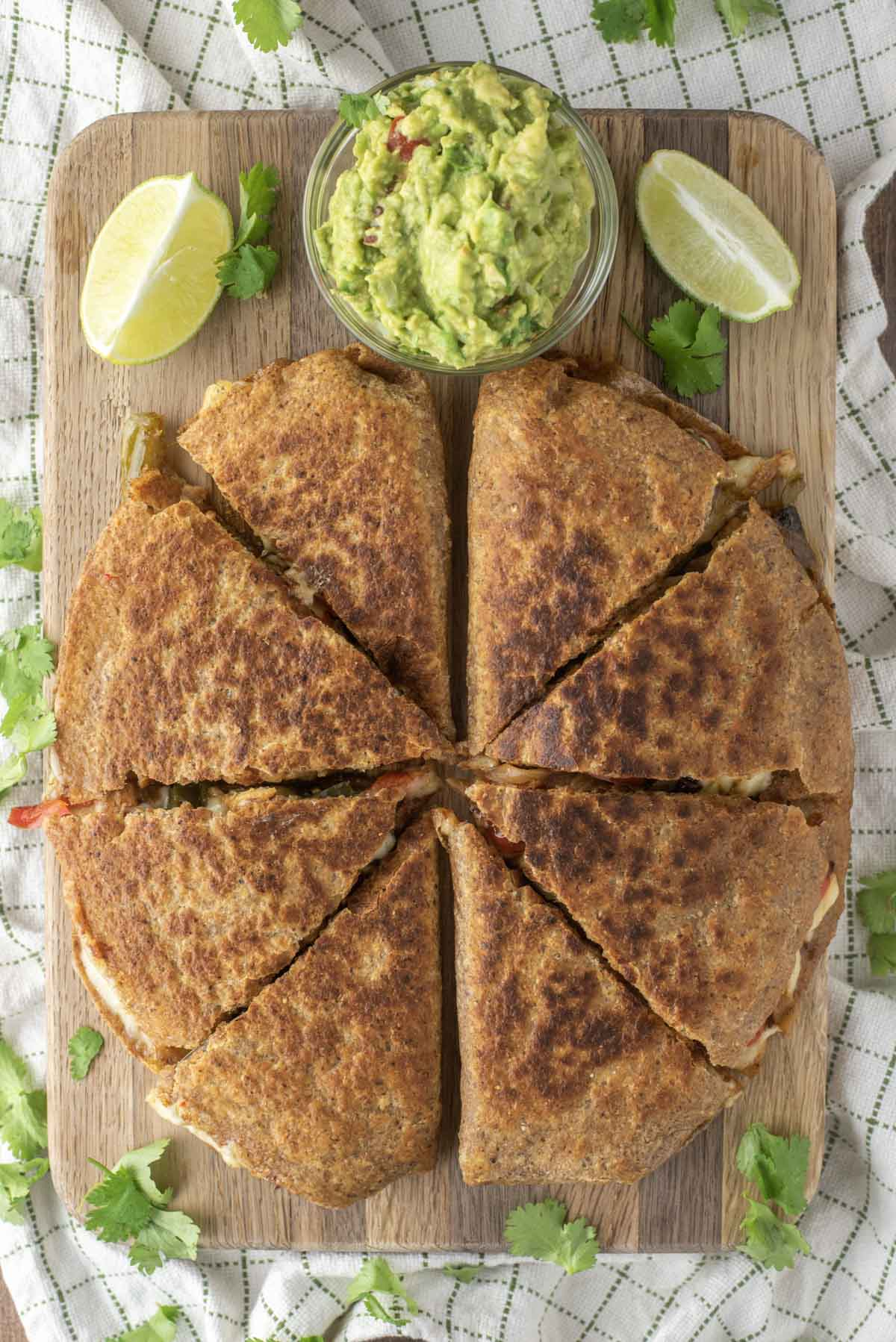 overhead shot of chicken fajita quesadillas on cutting board
