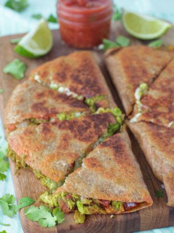 close-up of chorizo and avocado quesadillas on cutting board