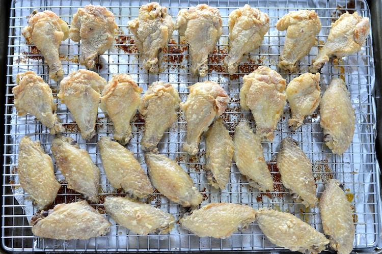 overhead shot of easy crispy baked chicken wings on baking sheet
