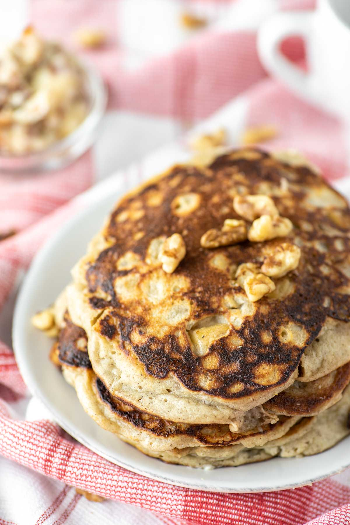 stacked apple ricotta pancakes on plate