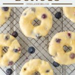 overhead shot of blueberry donuts on cooling rack