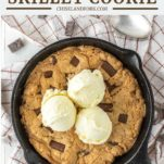 overhead shot of chocolate chip peanut butter cookie with vanilla ice cream in skillet