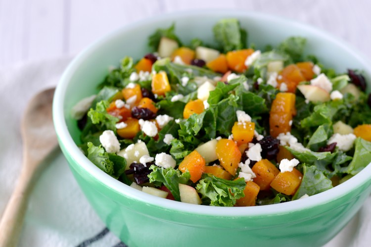 close-up of fall harvest salad in green bowl