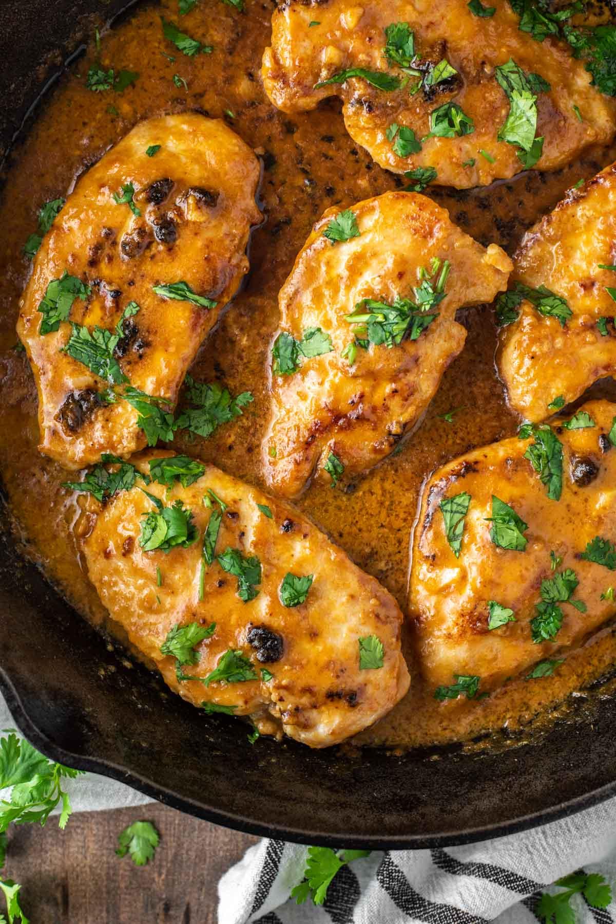 overhead shot of Thai chicken satay in skillet