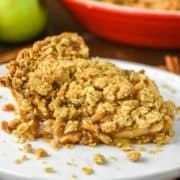 slice of apple crumb pie on white plate