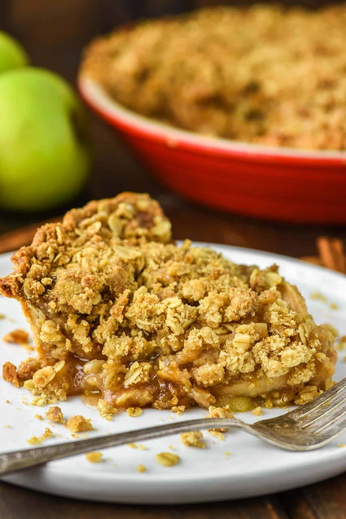 close-up of easy apple crumb pie in red pie dish