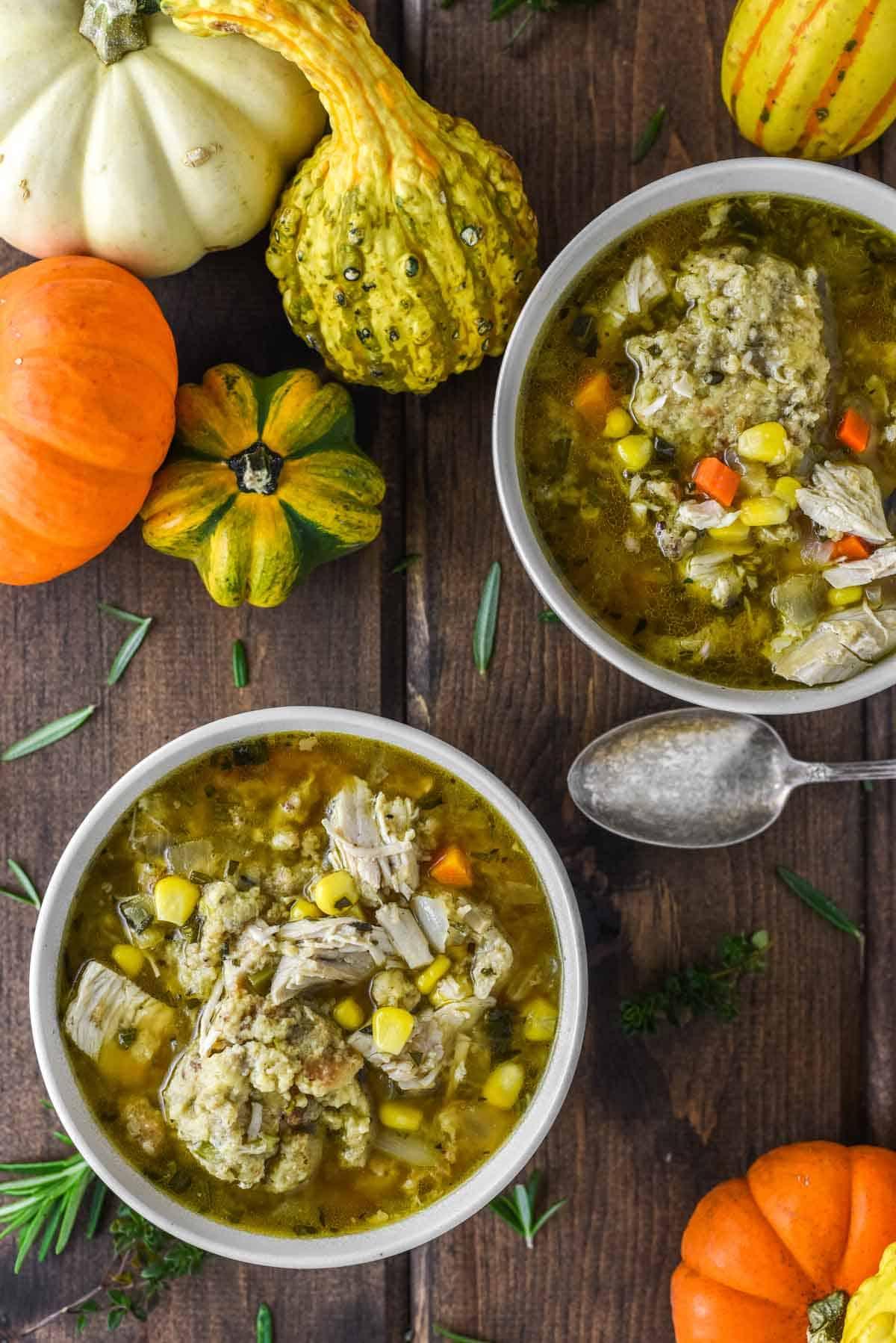 overhead shot of two bowls of turkey stuffing dumpling soup