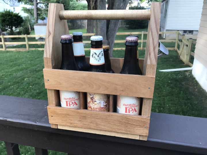 side view of beer caddy outside on rail