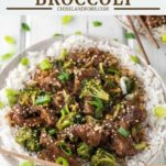 slow cooker beef and broccoli on two plates with chopsticks