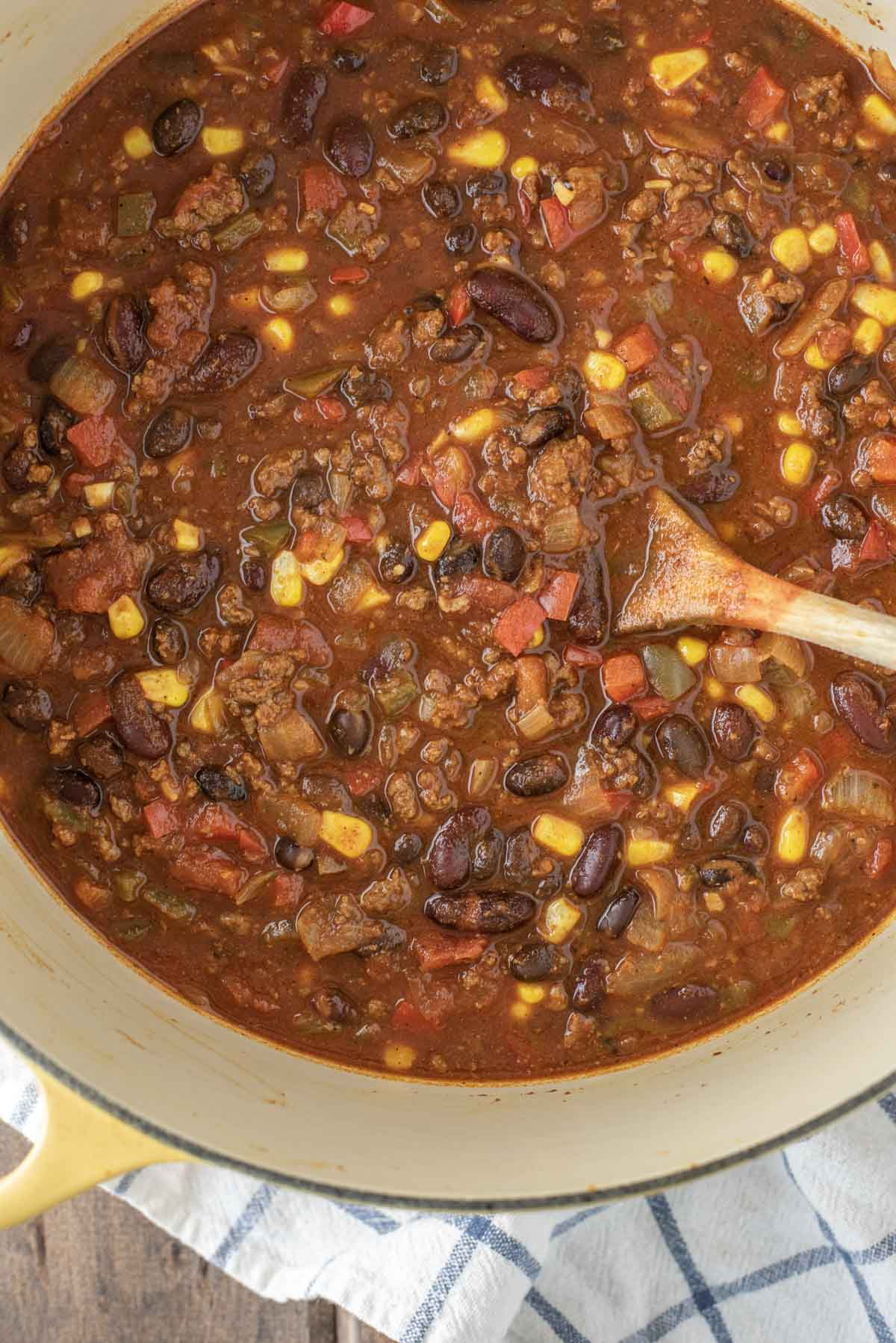 overhead shot of beef chili in yellow Dutch oven