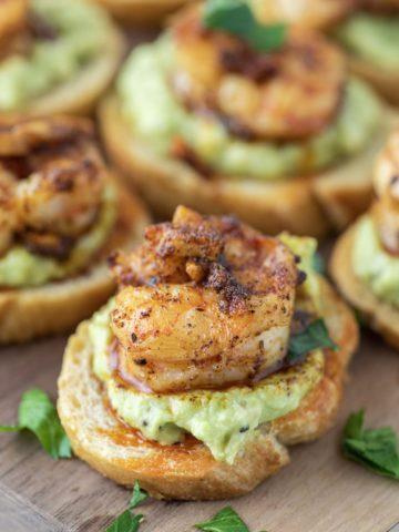 shrimp crostini on cutting board