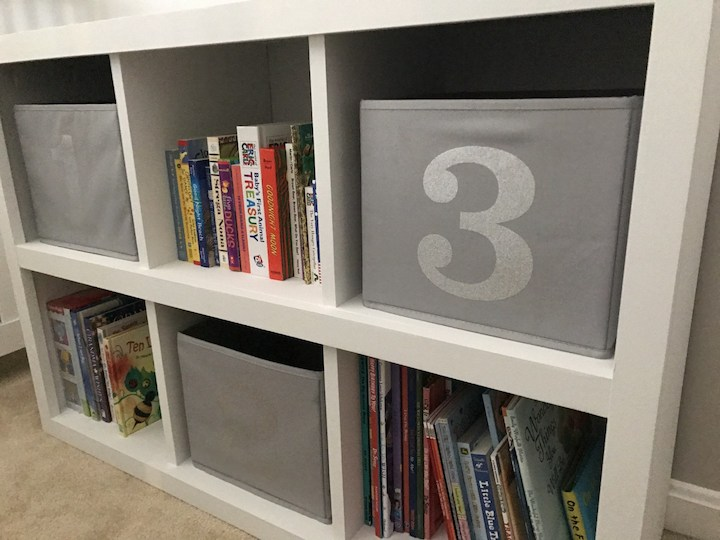 side view of white 6 cube bookshelf with books
