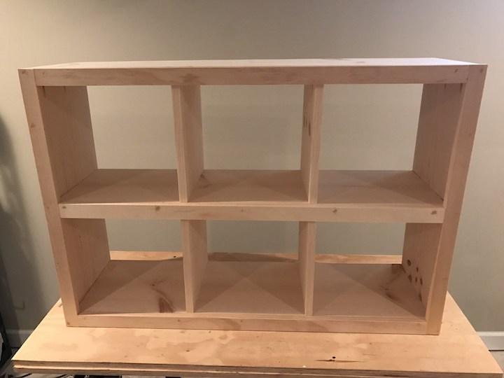 trim glued and nailed to 6 cube bookshelf
