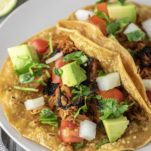 slow cooker chicken tacos on plate
