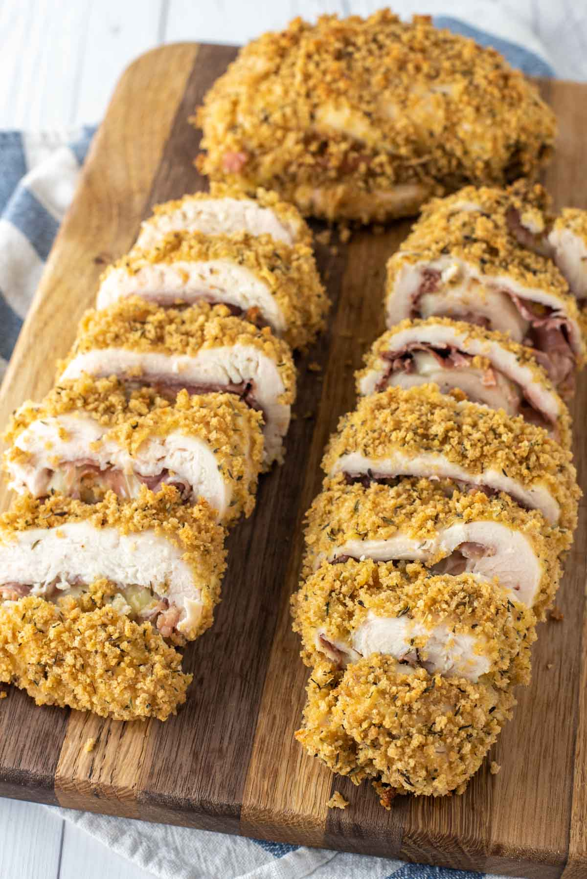 closed-up of sliced baked chicken cordon bleu on cutting board