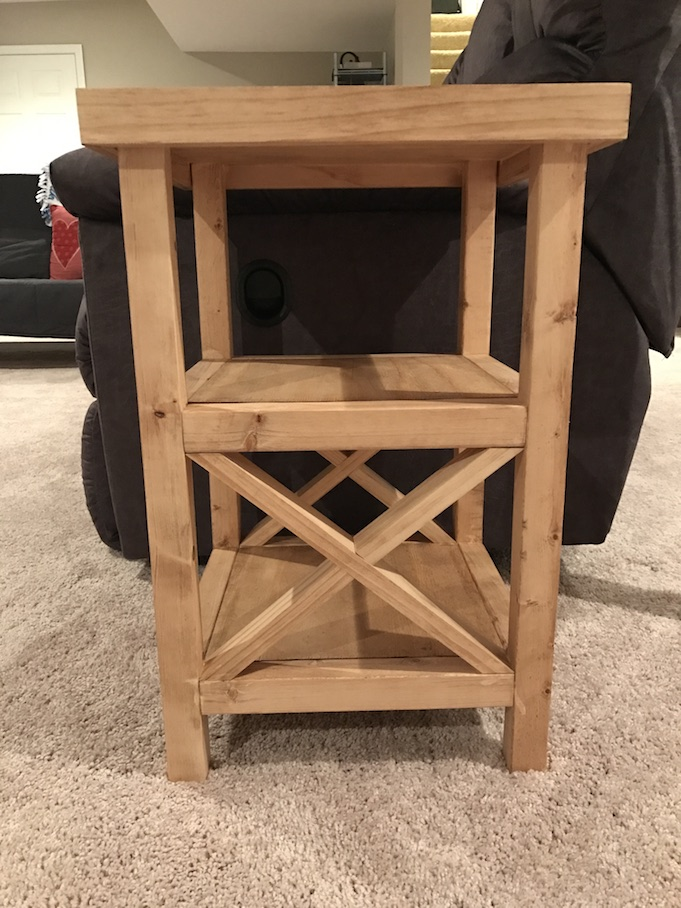 x end table stained and next to couch