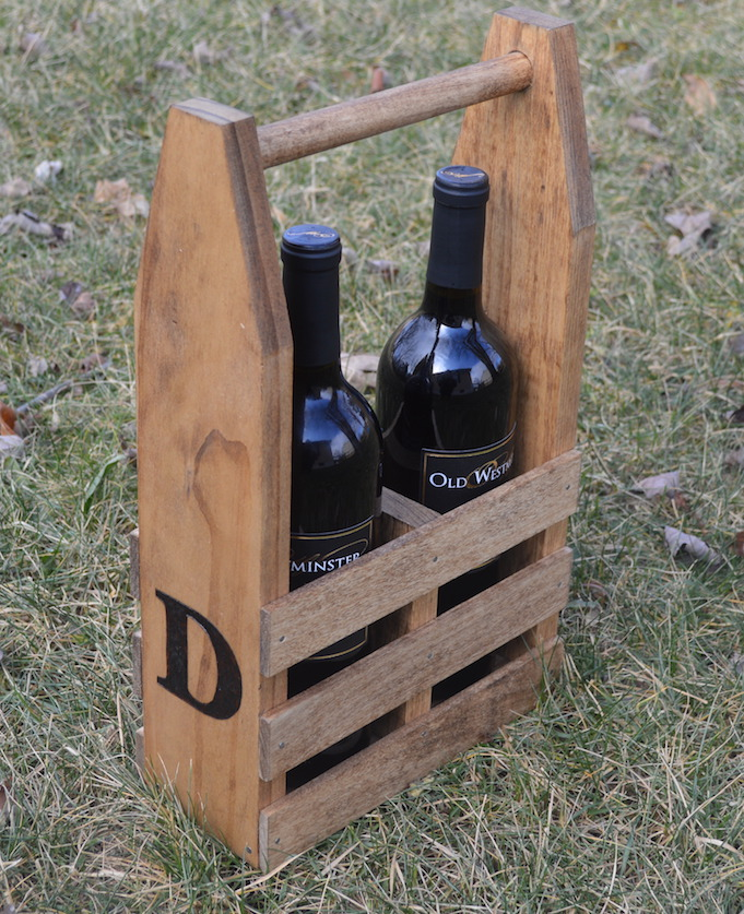 wine caddy on grass with two bottles of wine
