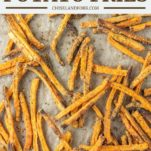 overhead shot of sweet potato fries on parchment-lined baking sheet