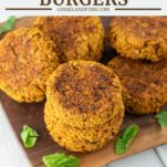 sun-dried tomato chickpea veggie burgers on wood cutting board