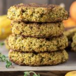stacked butternut squash burgers on cutting board