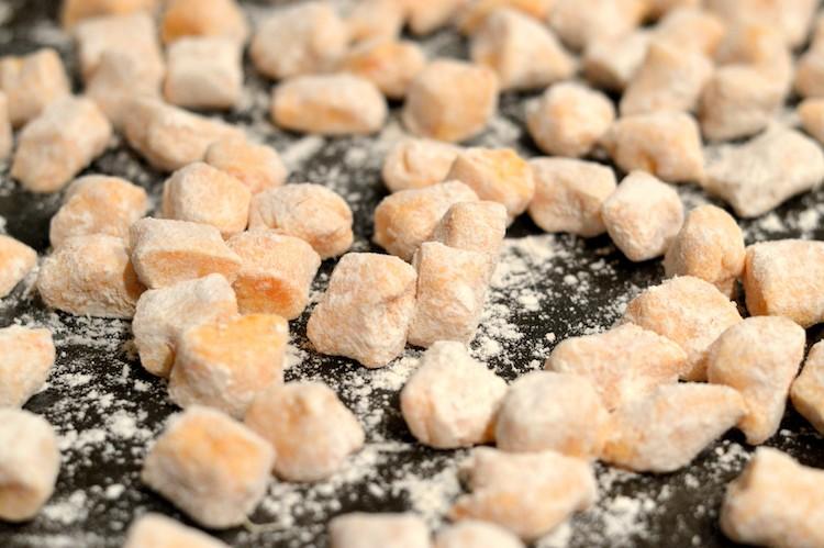 close-up of gnocchi on baking sheet