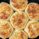 overhead shot of buttermilk biscuits in cast iron skillet