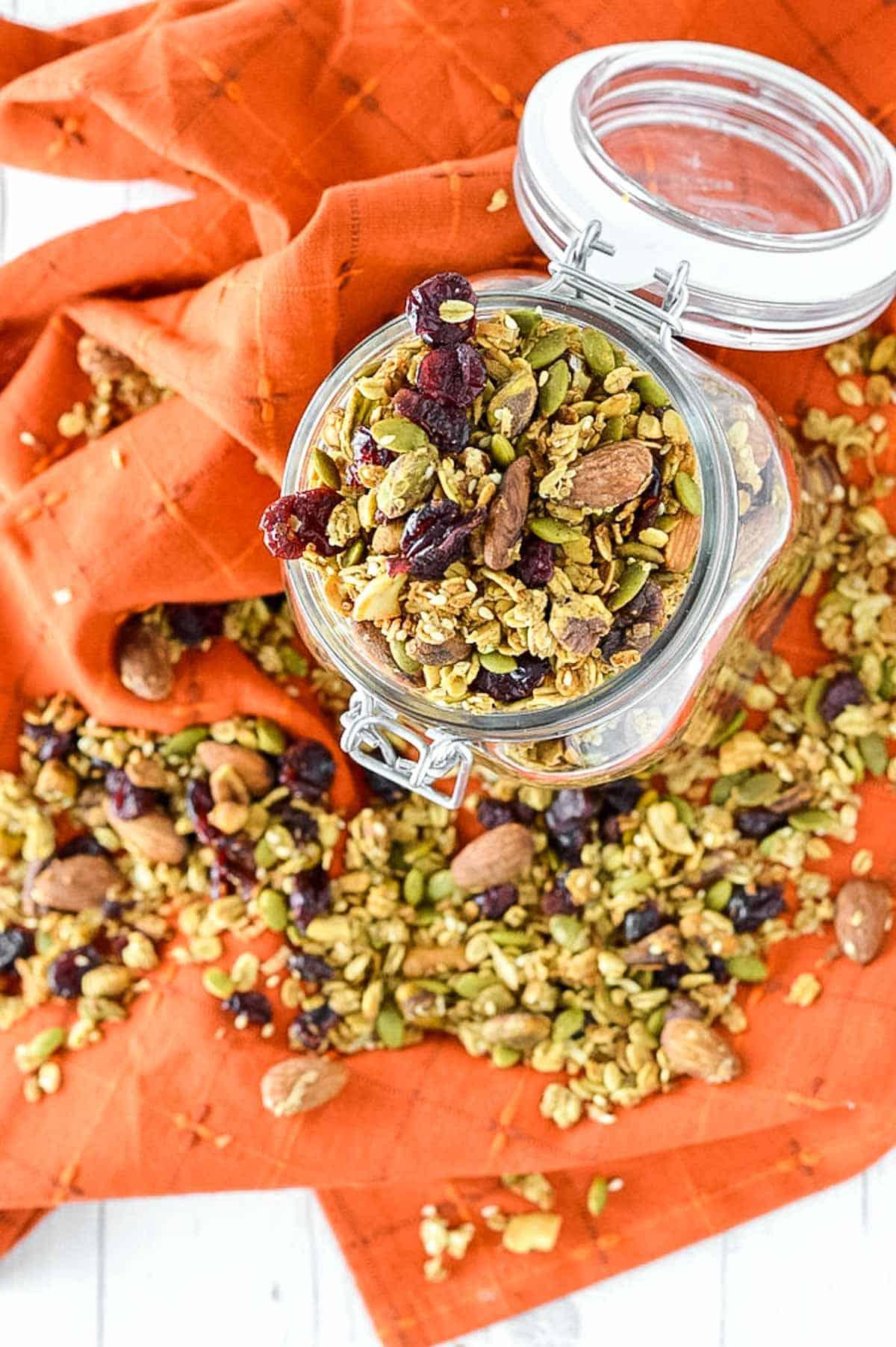 overlay of pumpkin spice granola in glass jar