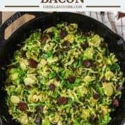 overhead shot of shaved brussels sprouts with bacon in skillet