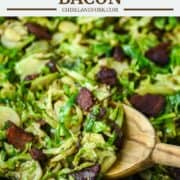 wooden spoon dipped in skillet with brussels sprouts