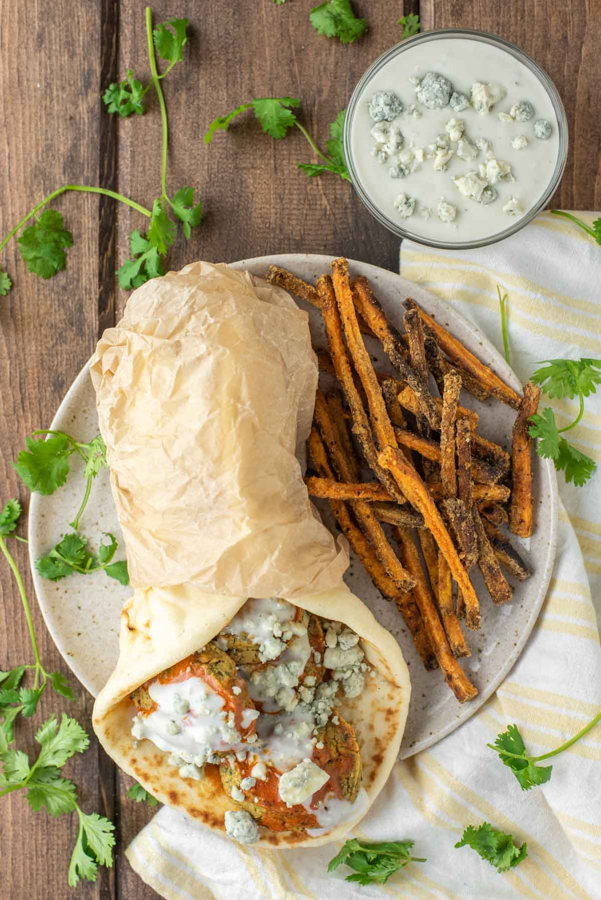 overhead shot of buffalo falafel with sweet potato fries on plate