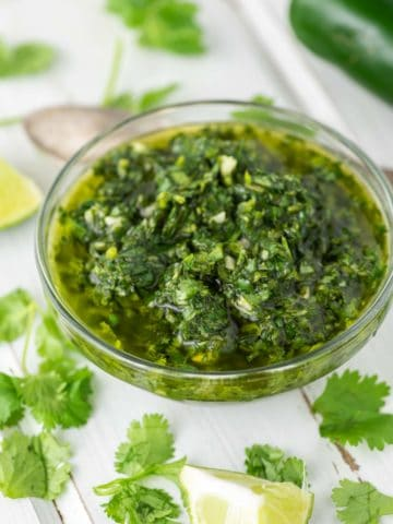 close-up of cilantro chimichurri sauce in white ramekin