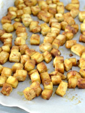 close-up of crispy baked tofu in baking sheet
