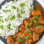 overhead shot of slow cooker Indian butter chicken in slate plate