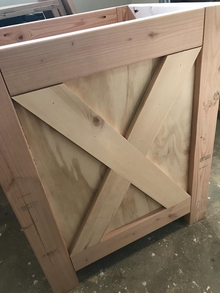 x on side of desk being glued together