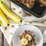 overhead shot of banana baked oatmeal on white plate and in square baking pan