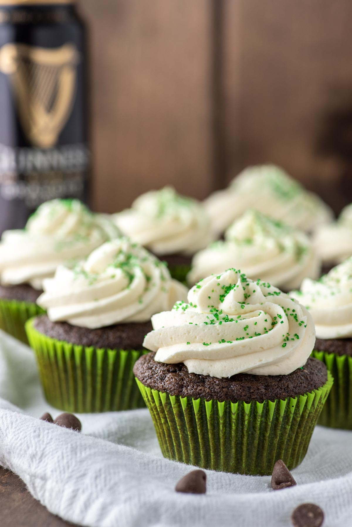 Irish Car Bomb cupcakes on white dish towel with Guinness beef in background