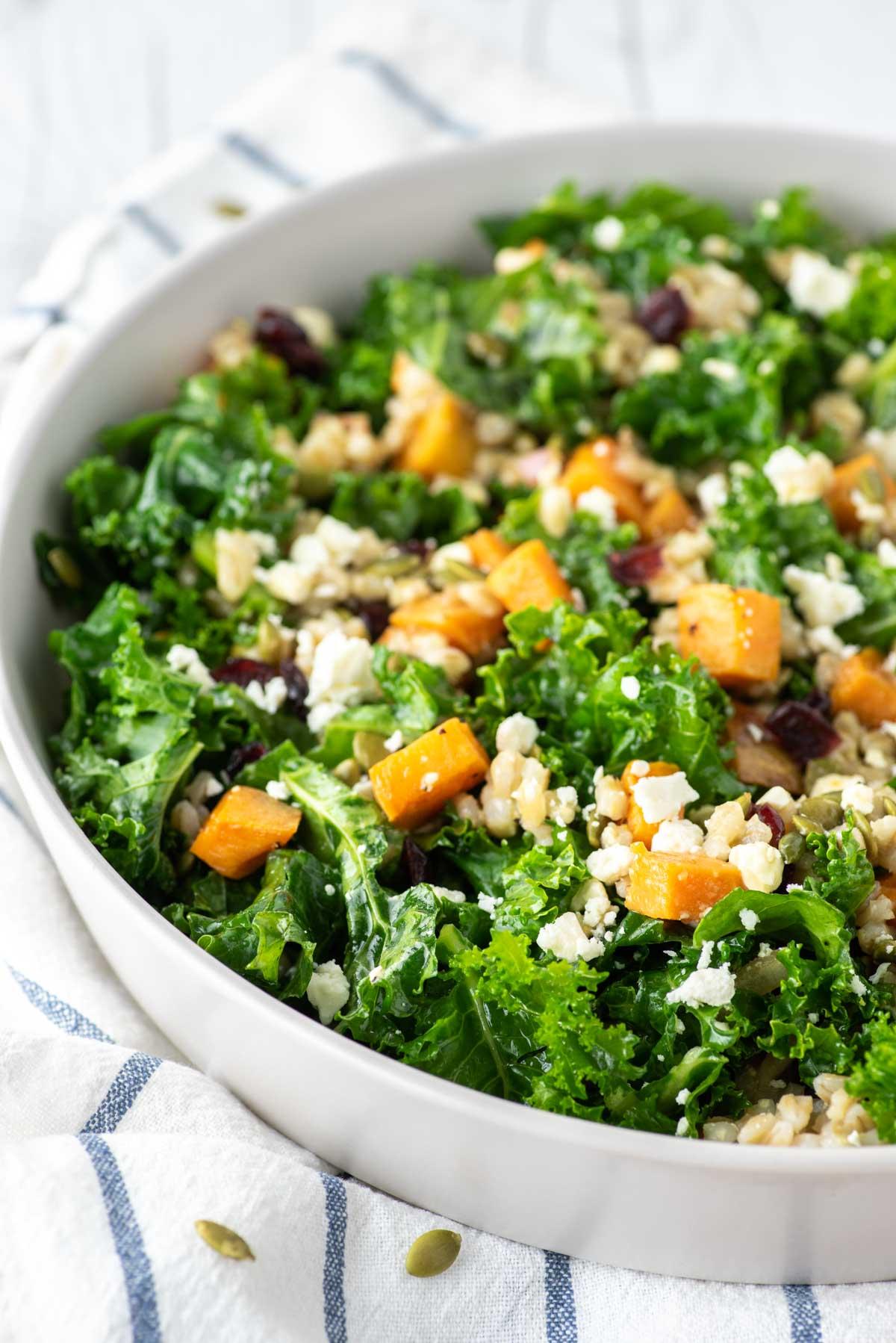 kale sweet potato salad in white bowl