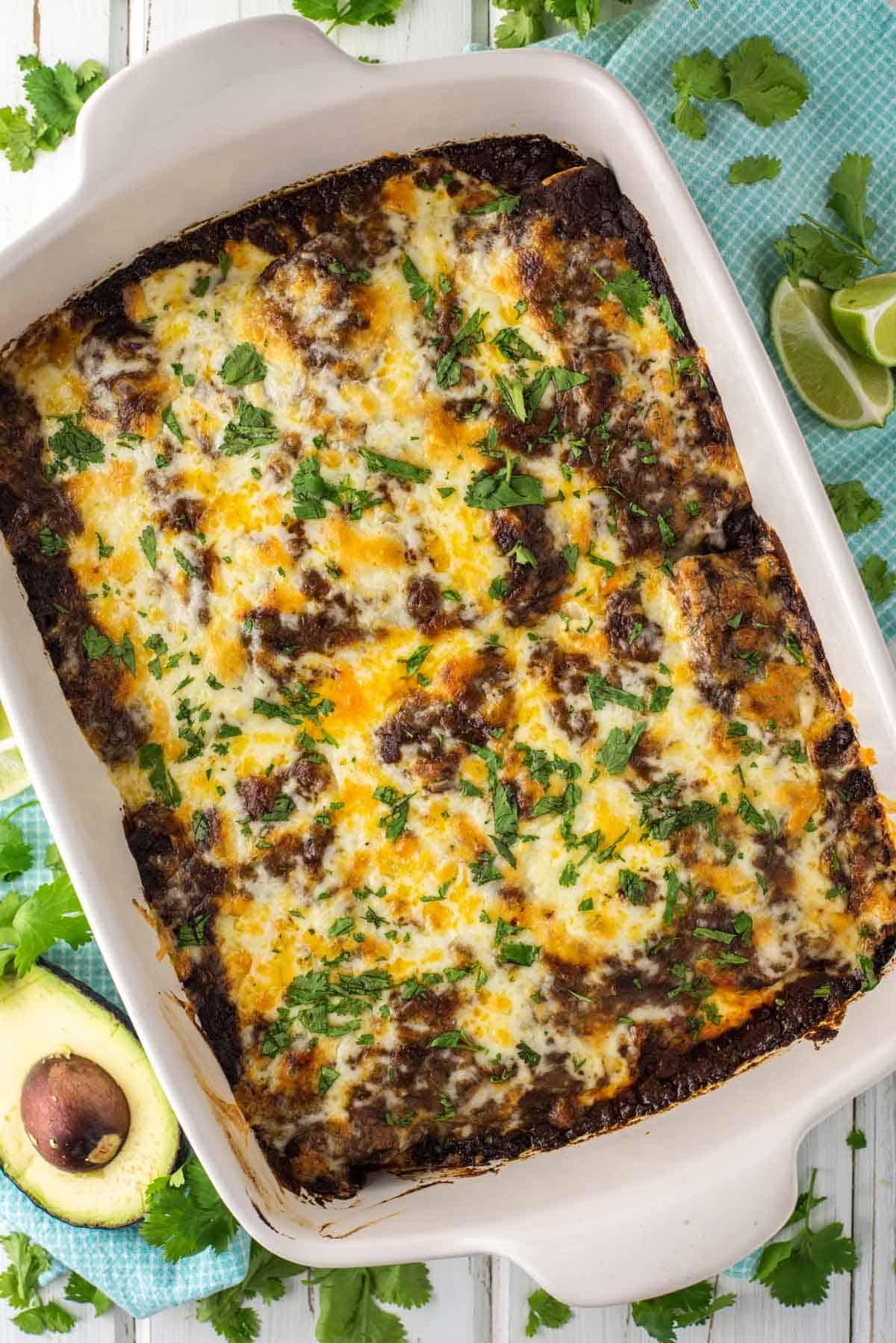 overhead shot of enchiladas in white pan