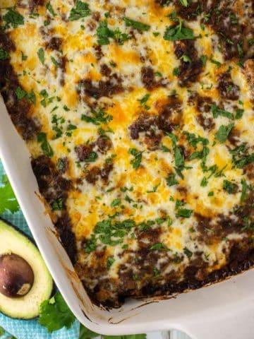 overhead shot of chicken mole enchiladas in pan