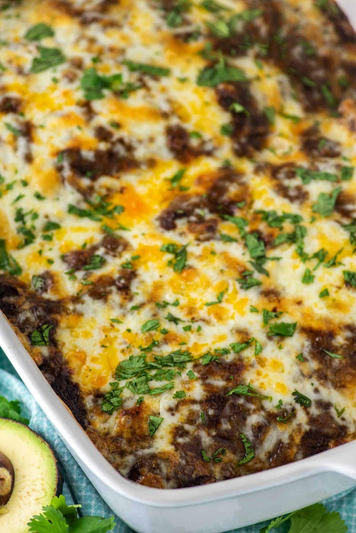 chicken mole enchiladas in white baking dish