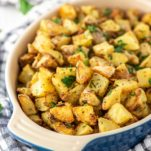 crispy roasted potatoes in blue oval dish